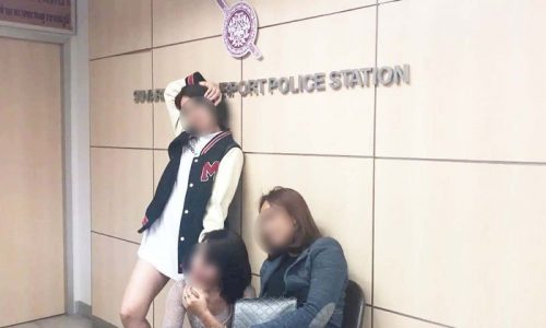 Stranded Tour Group Pose For Pictures Outside Police Station Instead Of Japan